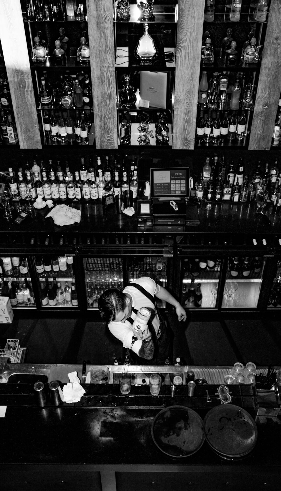 Bartender pouring a drink at the bar. Advertising photographer Birmingham, commercial photography in Birmingham and West Midlands