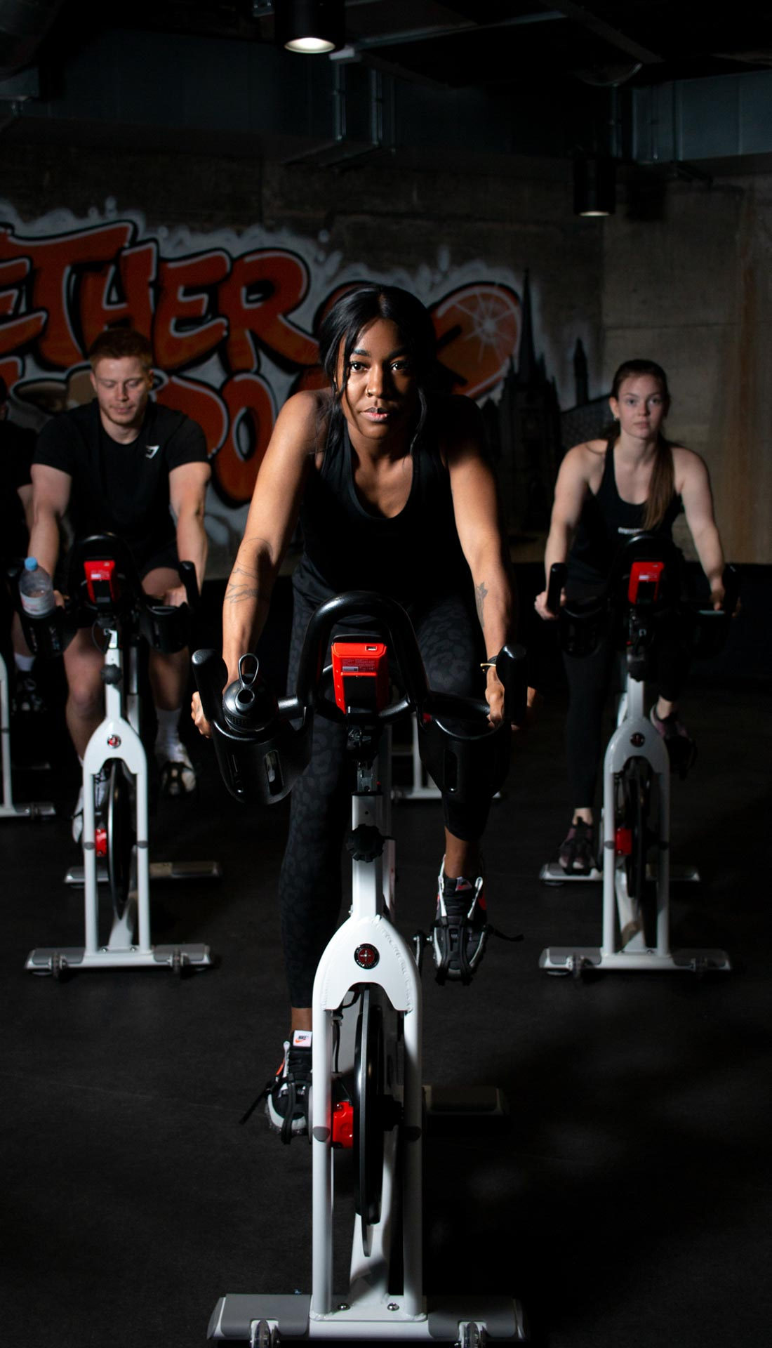 Fitness cycling class. Commercial photography for Birmingham MK Health Hub