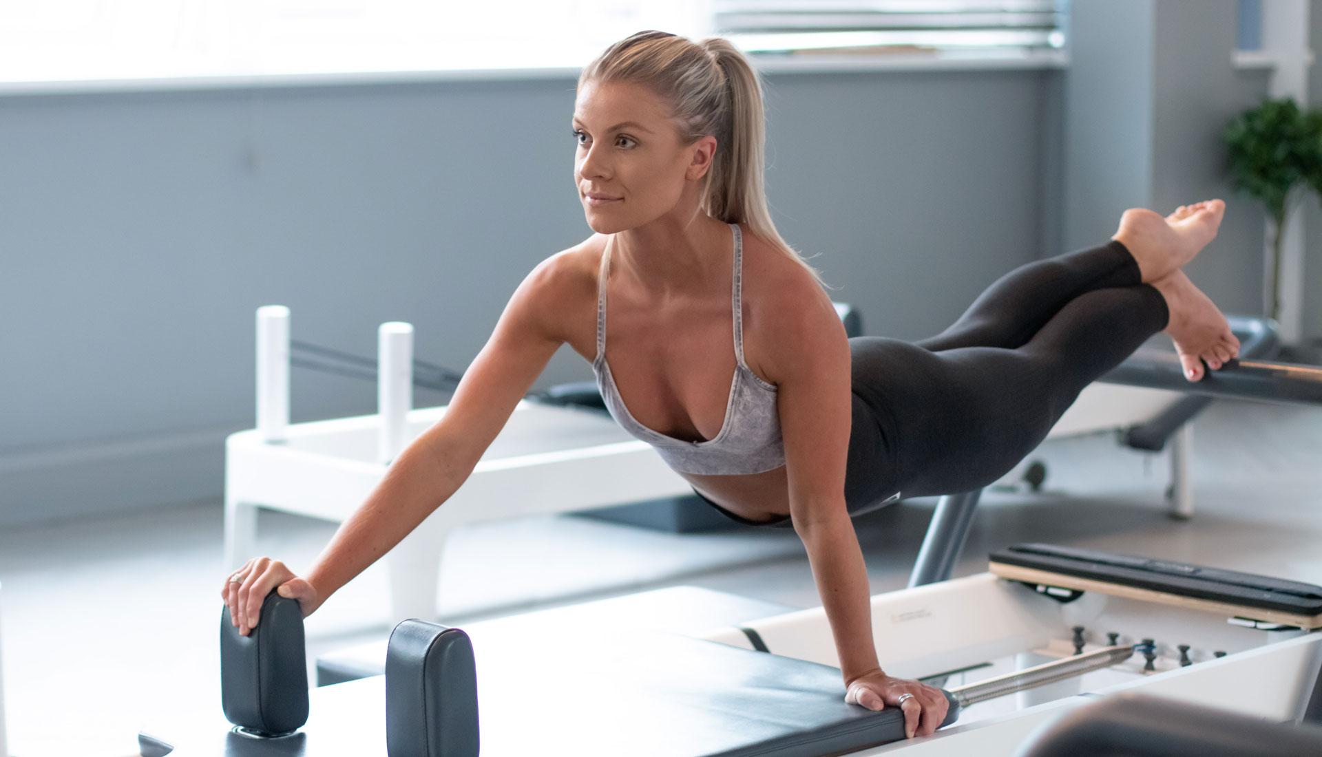 Blond woman doing pilates at the gym. Fitness photoshoot birmingham uk, fitness photographer UK, professional gym photography West Midlands