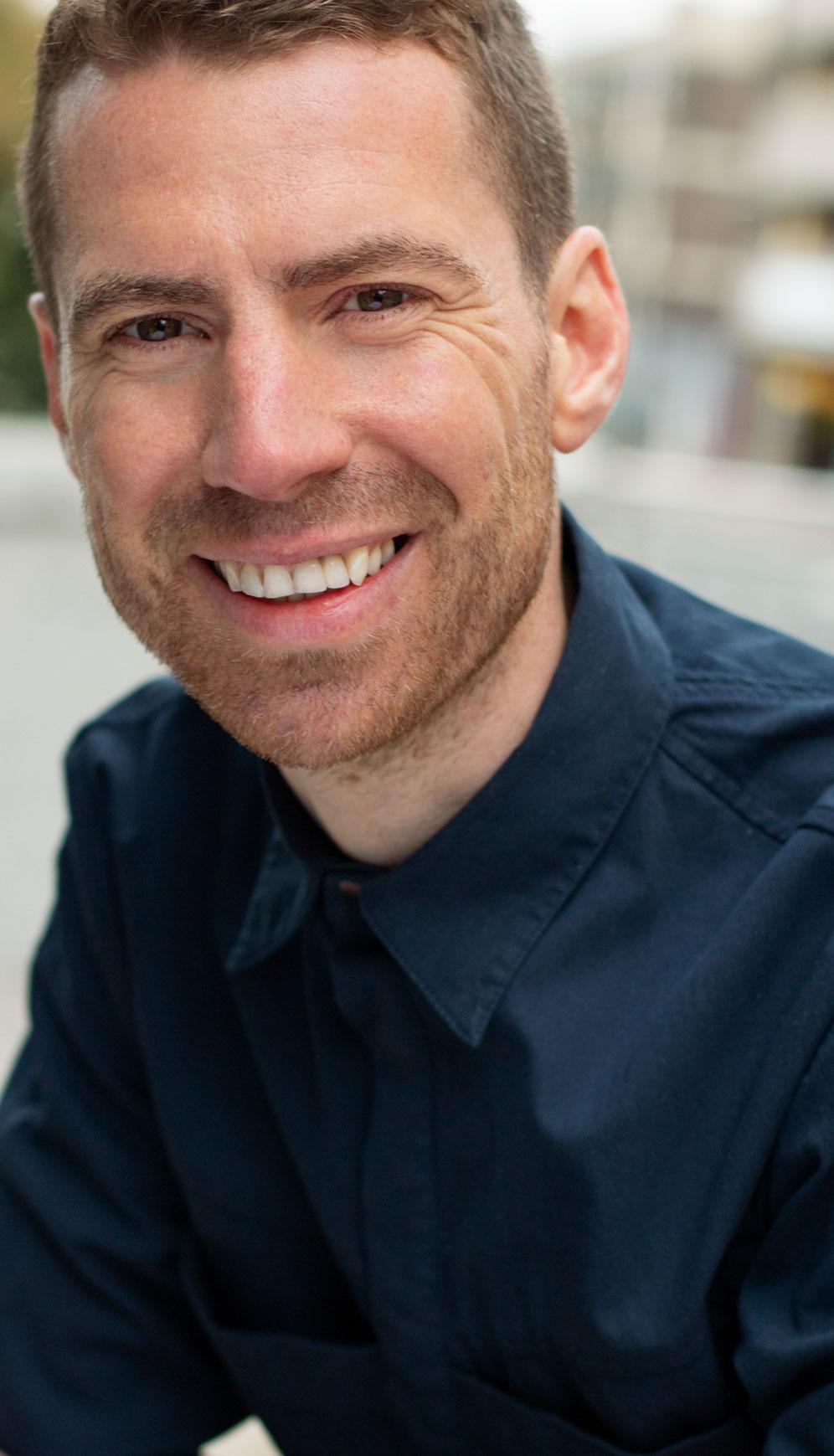 Portrait of a white man smiling. Outdoor portrait photoshoot in Birmingham U.K.