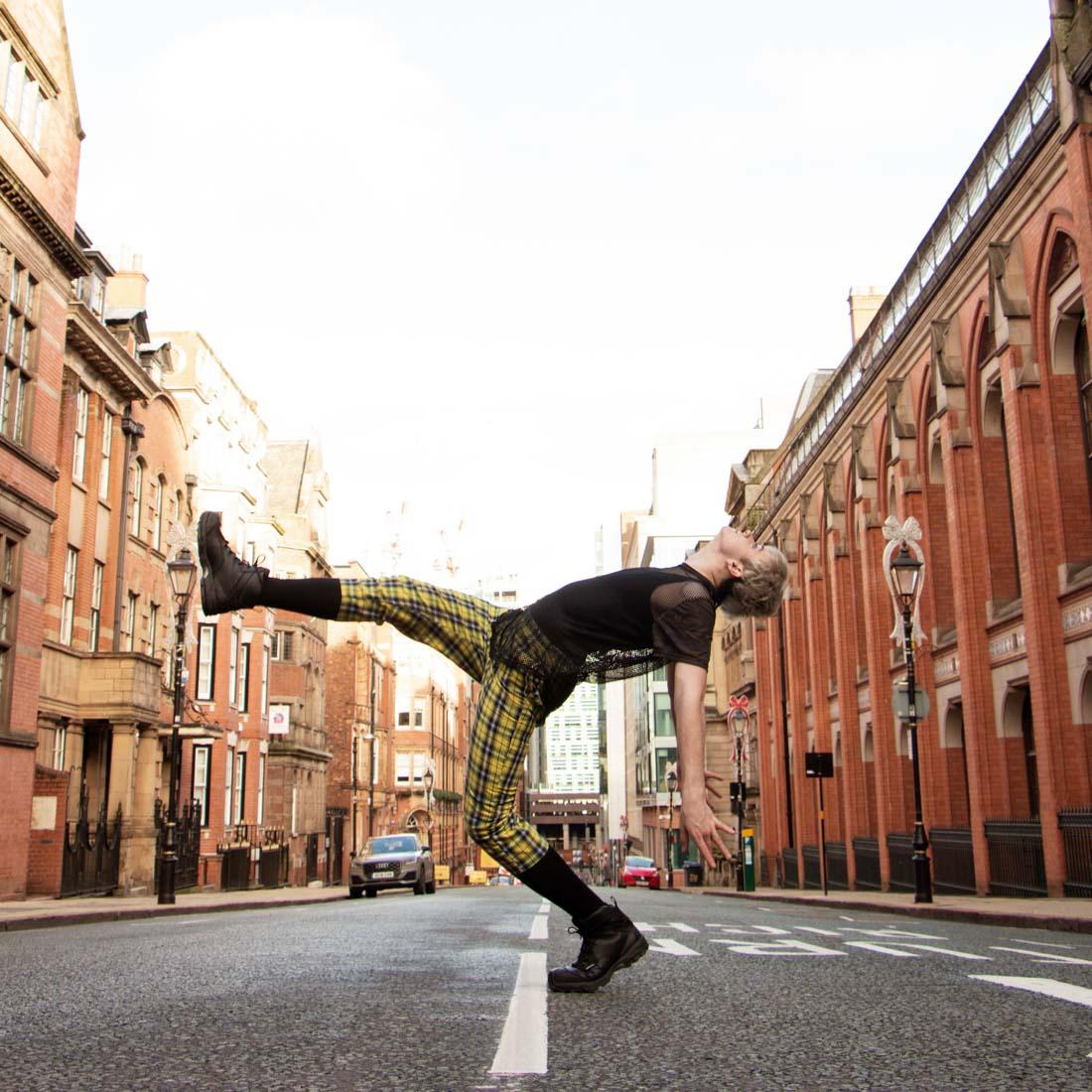Birmingham U.K. dance photography. Male dancer dancing in the street