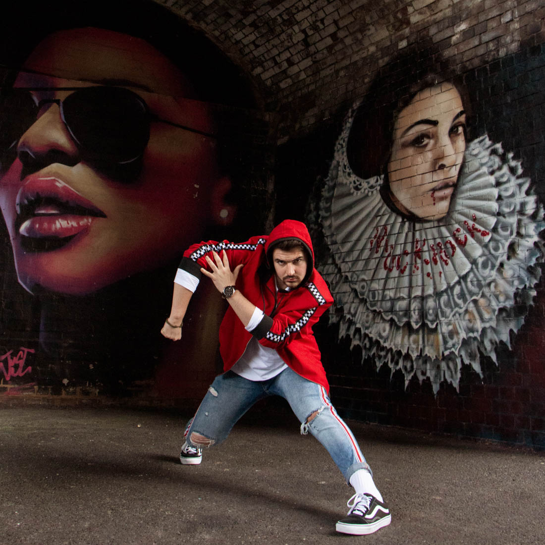 Street dancer striking a pose in front of graffiti wall. Birmingham Digbeth, dance photoshoot