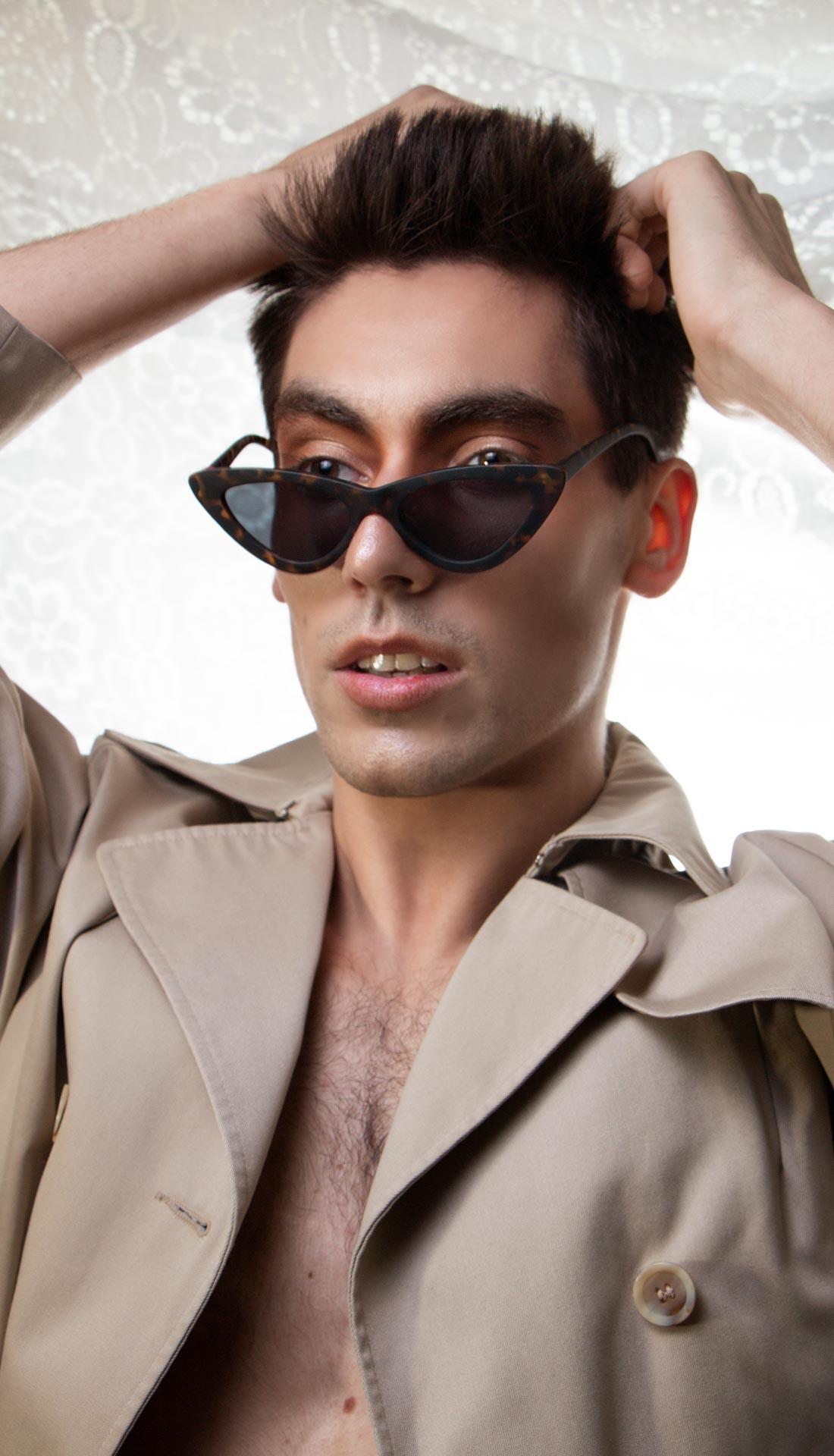Male model posing in sunglasses. Fashion portrait, men's fashion photoshoot, commercial sunglasses photoshoot, commercial and fashion photographer Birmingham