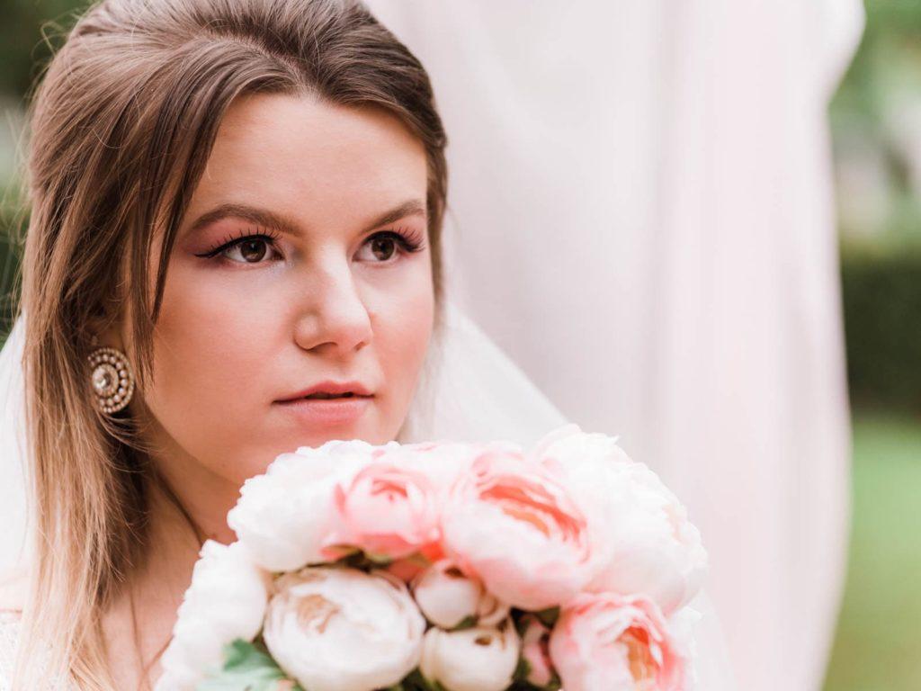 Portrait of a bride, bride holding wedding bouquet