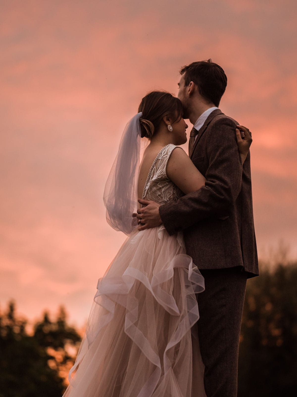 Golden hour photoshoot, sunset wedding photoshoot, bride and groom hugging each other