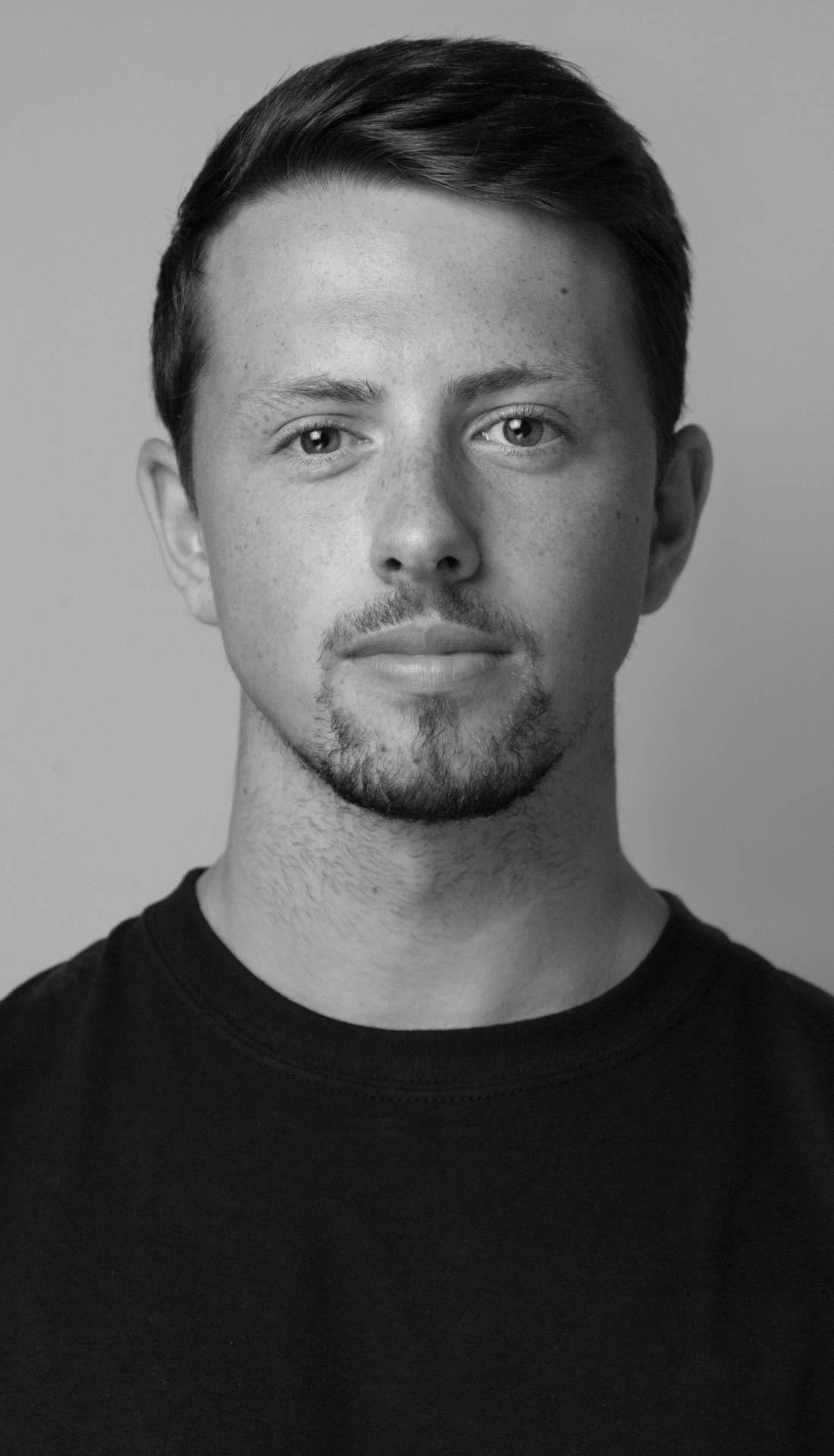 A black and white headshot of a Birmingham based personal trainer Ellis. Birmingham headshots, personal branding photography