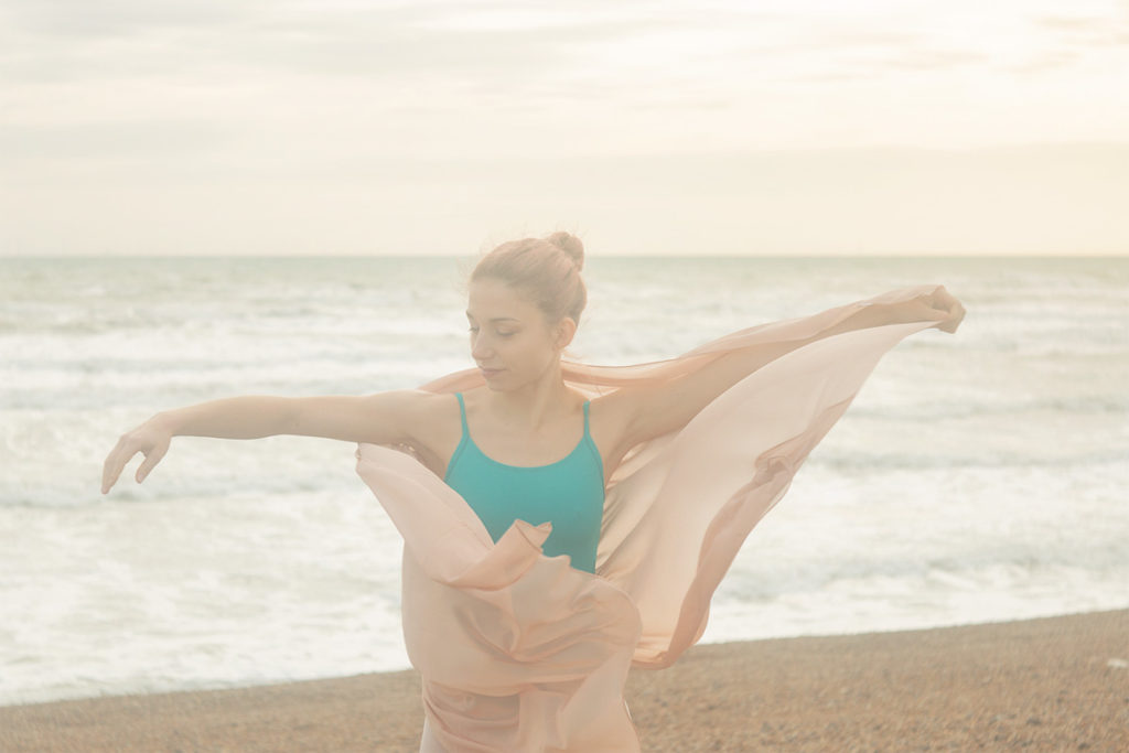 Artistic outdoor ballet photography on the beach uk - ballerina wrapped in scarf - AnastasiaJobson Photography
