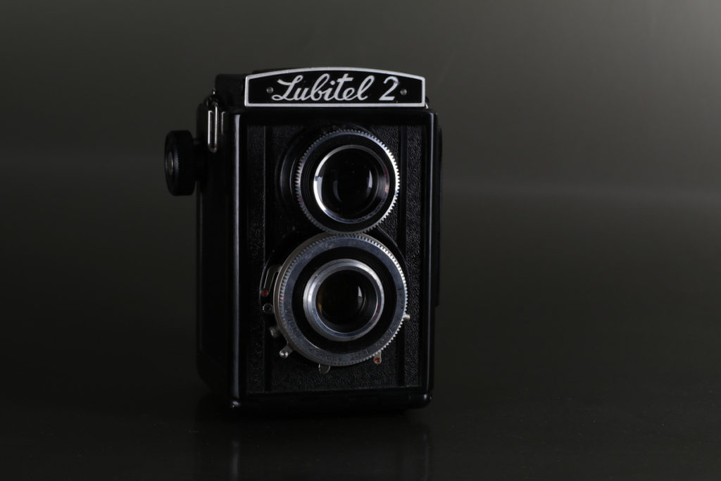 Vintage 120mm film camera Lubitel 2 on plain grey background