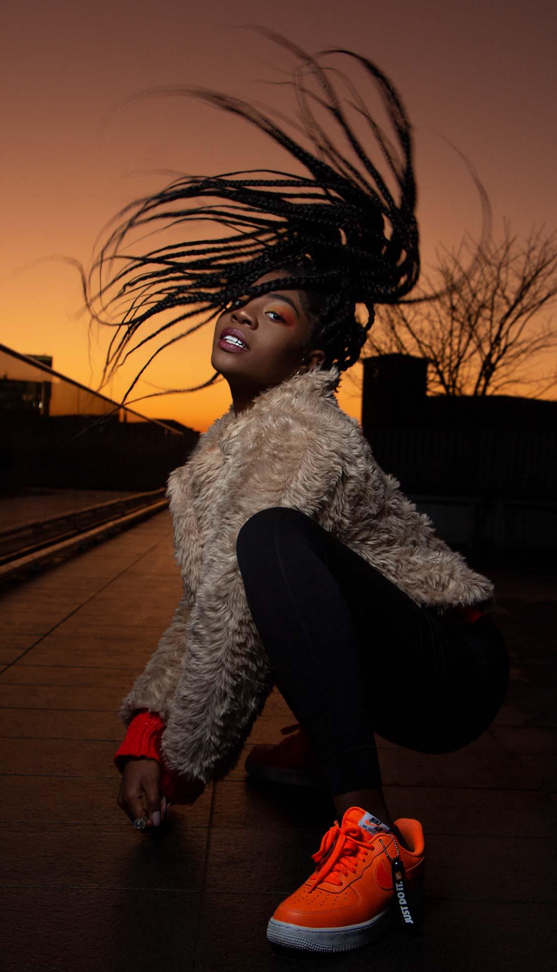 Outdoor fashion photoshoot in Birmingham UK, Nike SB orange shoes, hair flick dance pose, dance photography Birmingham, Fashion photography Birmingham and West Midlands