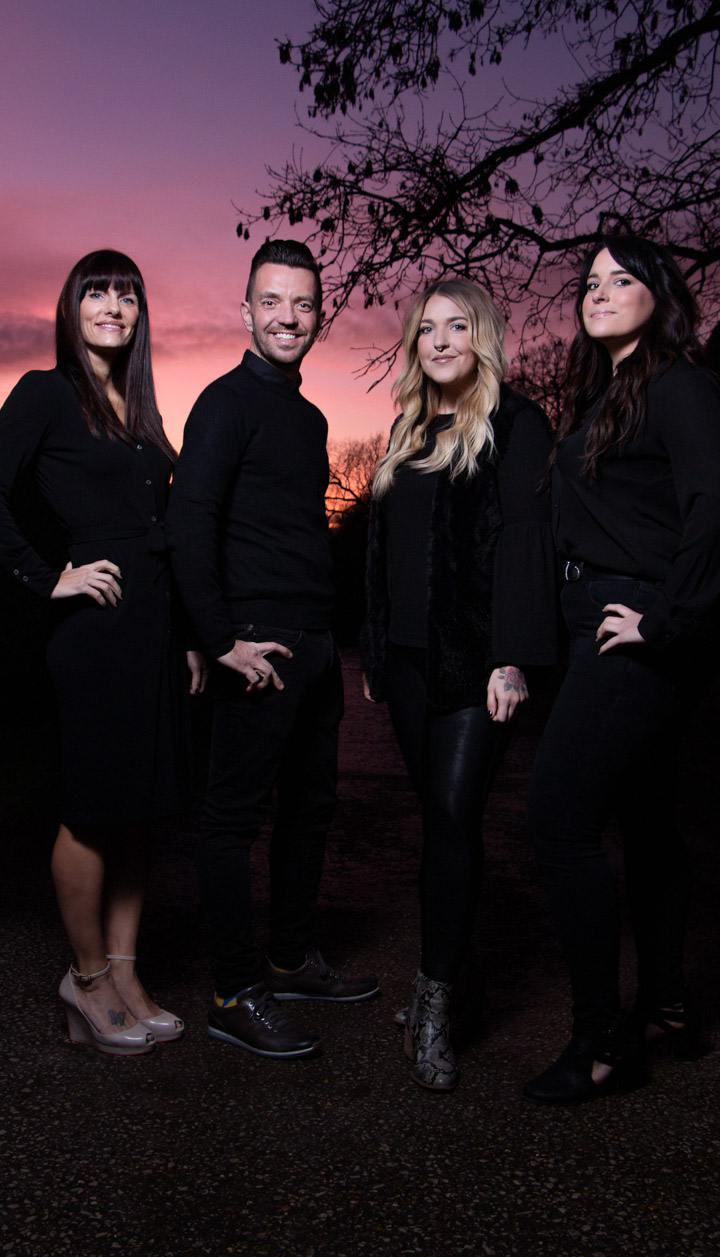 Business photo of a team of hairstylists during sunset.