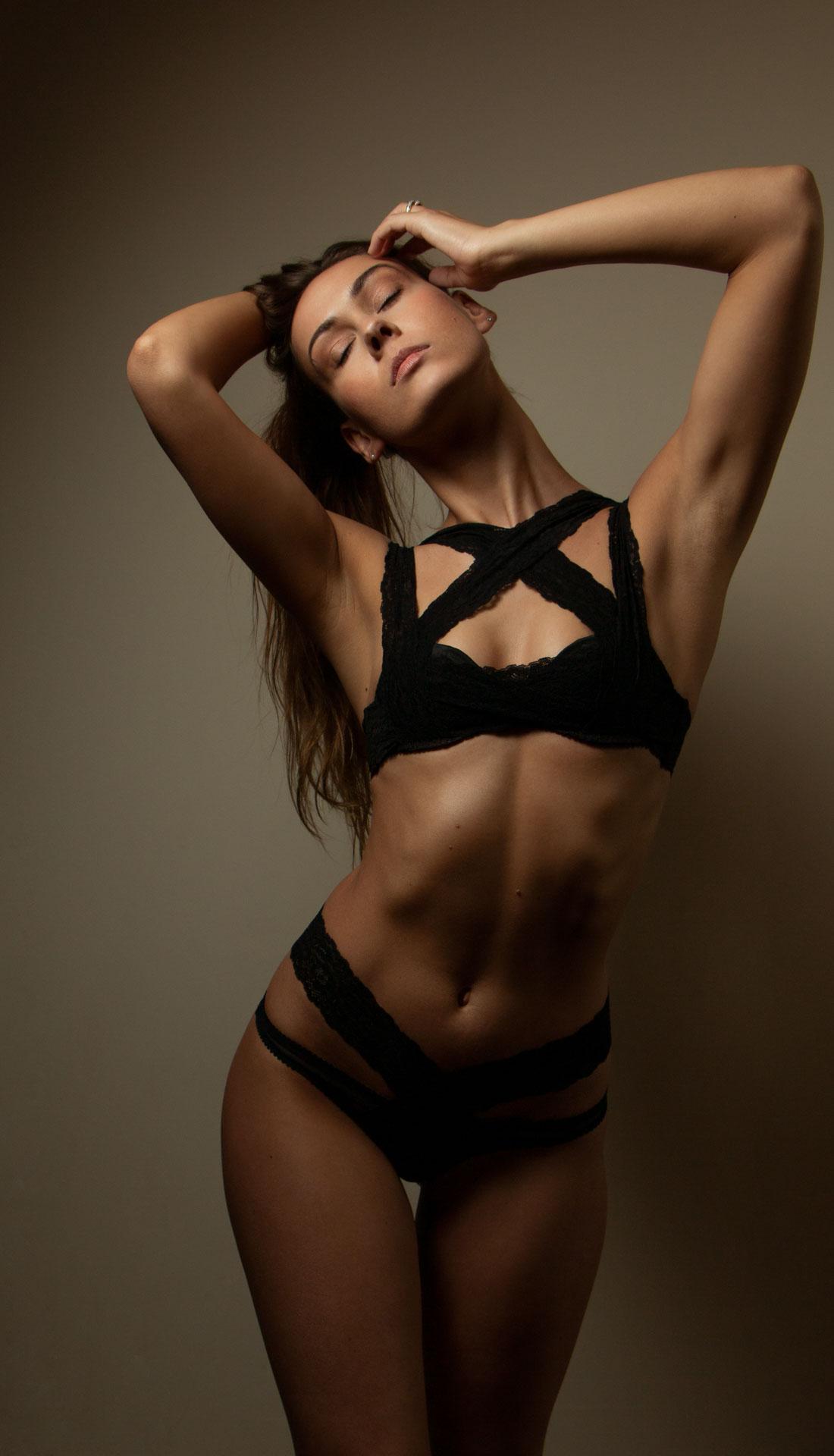 Lingerie fashion photography, a female model posing wearing black Agent Provocateur lingerie, boudoir photography Birmingham