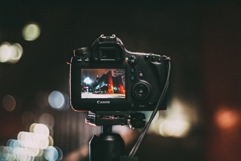 TikTok for photographers. A Canon camera on a tripod taking image of a city at night