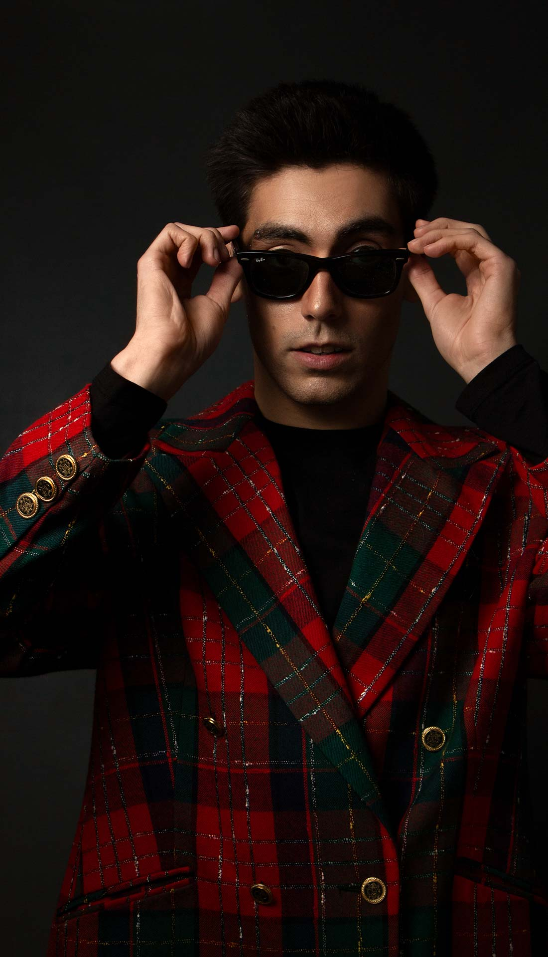 Commercial fashion portrait of a male model posing with Rayban sunglasses. Fashion photographer birmingham, commercial photography Birmingham UK