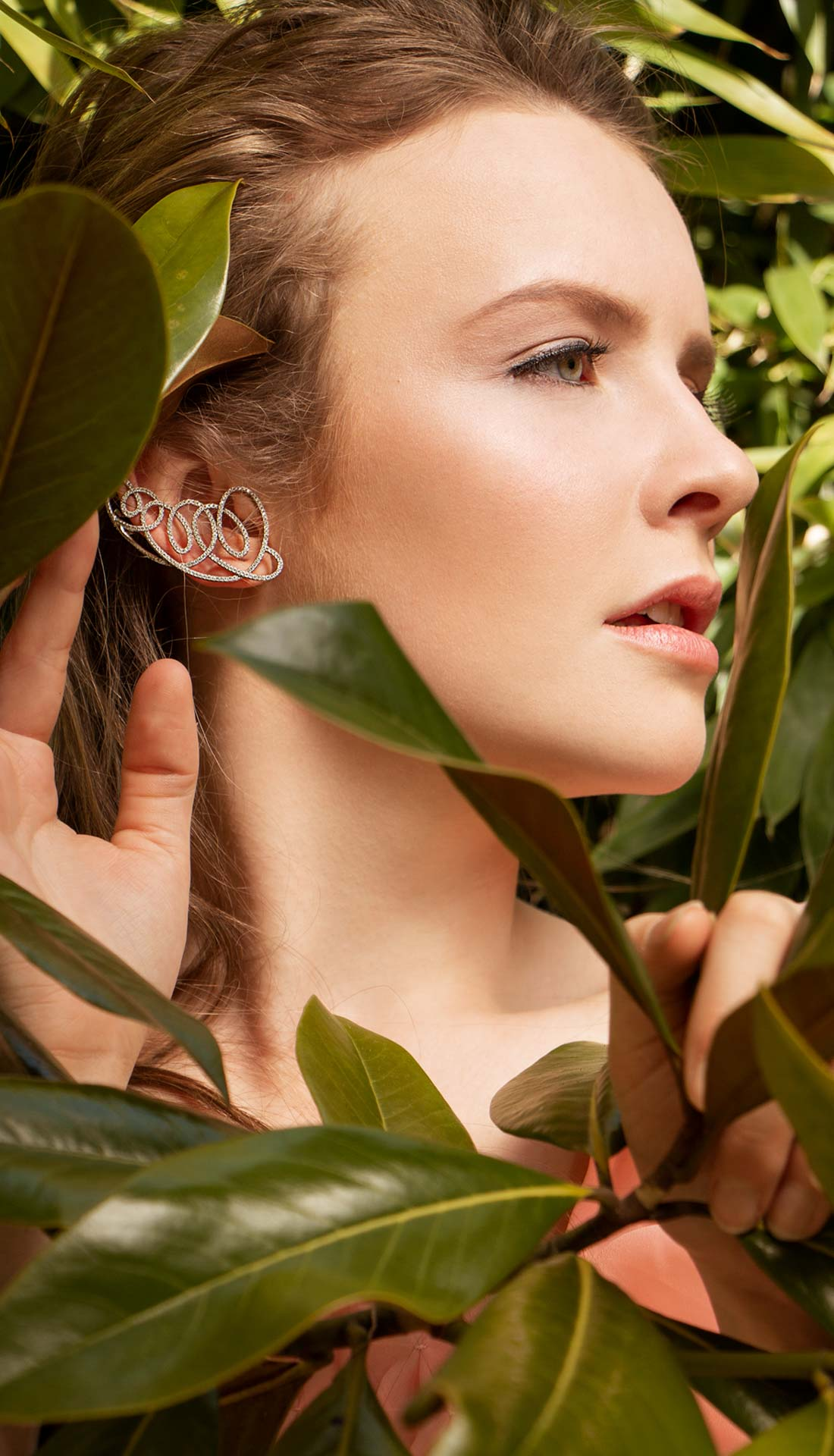 A brunette female model posing in fashion jewellery in a jungle. Jewellery photography Birmingham uk, Commercial photographer Birmingham, jewellery fashion, fashion photographer Birmingham and West Midlands