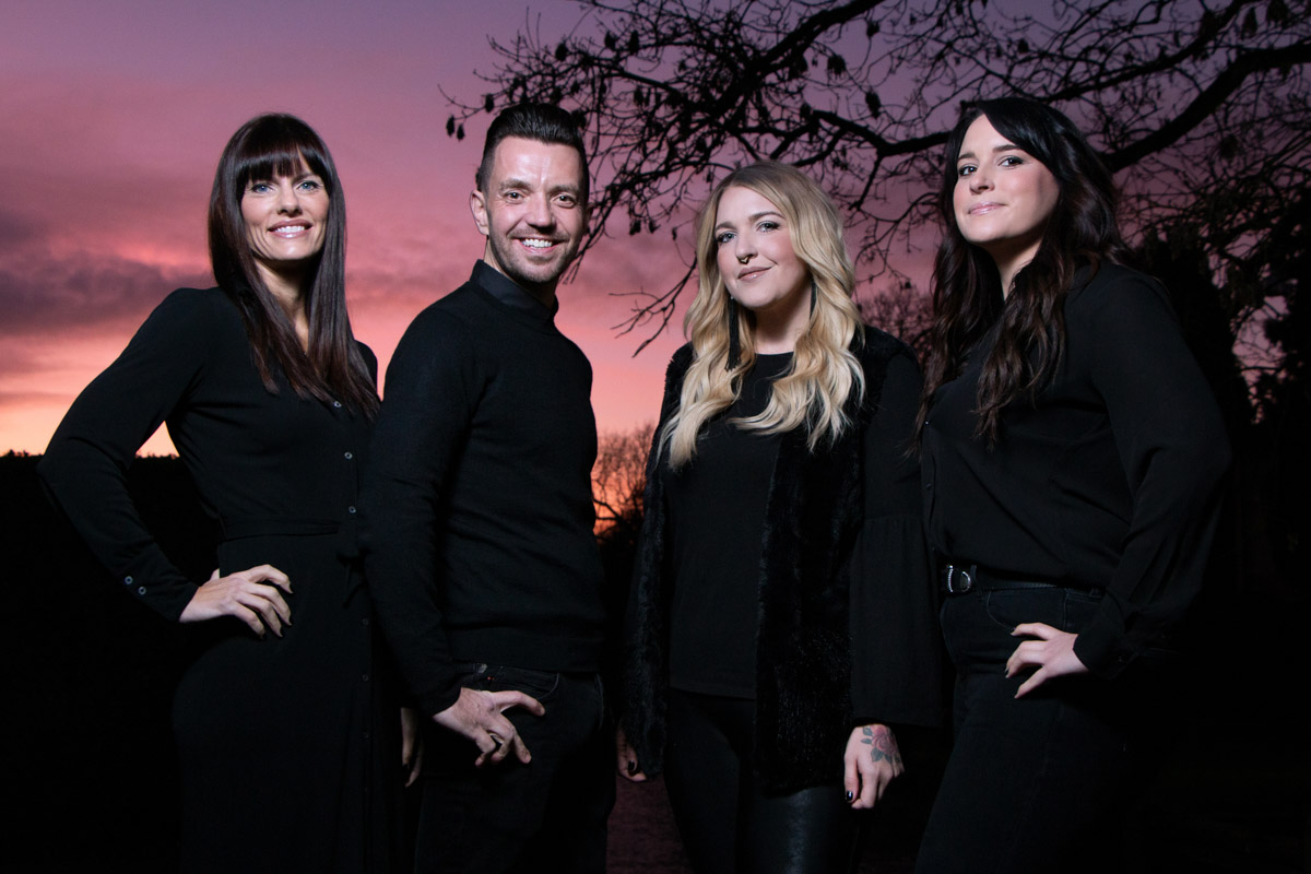 Four hairstylists posing for a group photo during sunset. Personal branding photography Birmingham U.K., business portraits and headshots in Birmingham and West Midlands