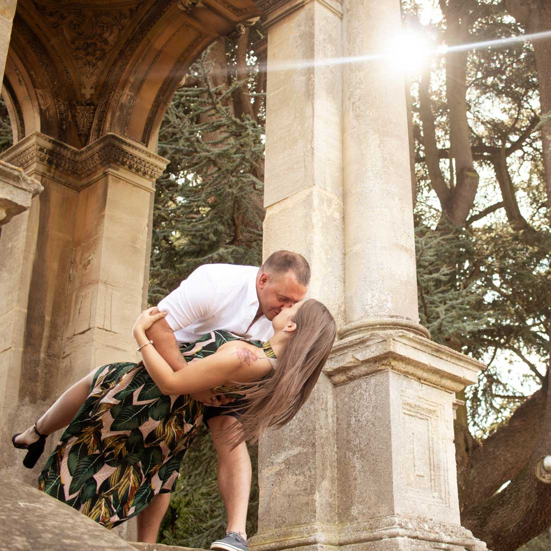 Romantic couple photoshoot in Witley Court and Gardens, Worcestershire. Passionate kiss of newly engaged couple. Engagement and wedding photography in West Midlands, U.K.